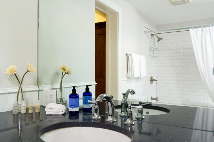 Black counter top with bath amenities.